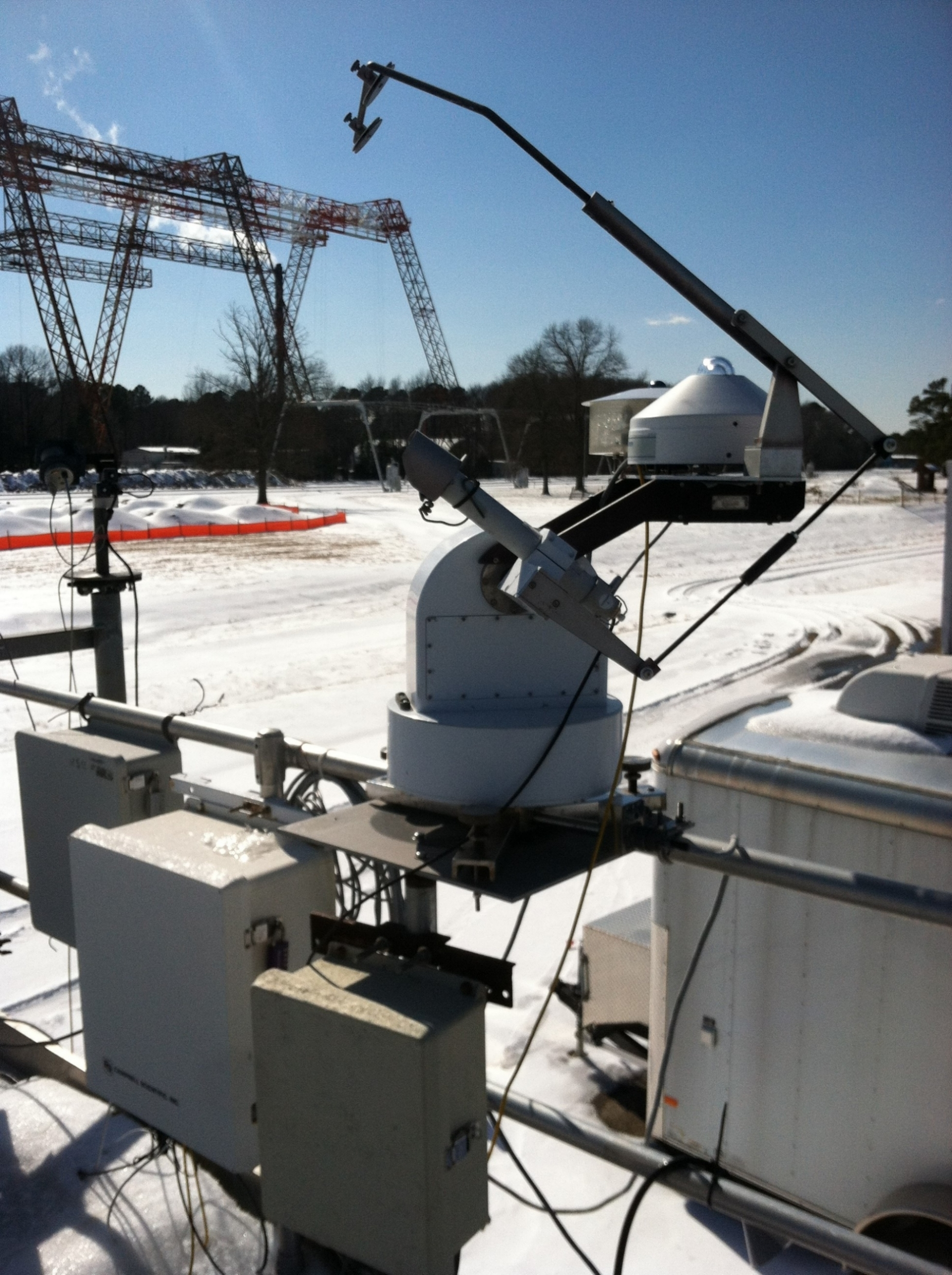 The BSRN-LRC sun tracker at the NASA Langley Research Center on a snowy day (02/20/2015)